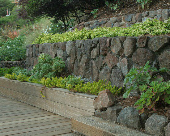 modern-landscape-traditional-style-stone-walls-wooden-paths